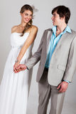 Smiling Young Couple Holding Hands Royalty Free Stock Images