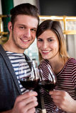 Smiling young couple holding wineglass royalty free stock images