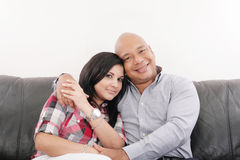 Smiling young couple at home Stock Photography