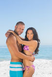 Smiling young couple hugging each other. On the beach Stock Image