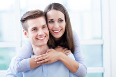 Smiling young couple hugging Stock Photo