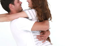 Smiling young couple hugging stock video
