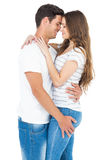 Smiling young couple hugging Royalty Free Stock Images