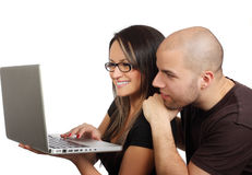 smiling young couple and laptop Royalty Free Stock Photo
