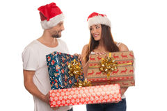 Smiling young couple with large Xmas gifts Stock Photos