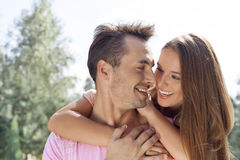 Smiling young couple looking at each other in park Royalty Free Stock Photo