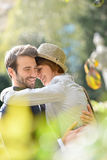 Smiling young couple in love hanging out in park Stock Photography