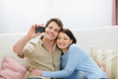 Smiling young couple making self photo Stock Photography