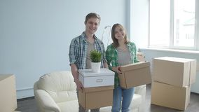Smiling Young couple moves to a new apartment stock video footage