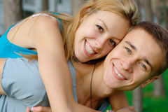 Smiling young couple outdoors Royalty Free Stock Photo