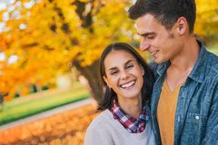 Smiling couple outdoors in park in autumn Royalty Free Stock Photo