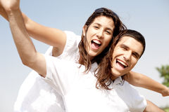 Smiling young couple piggyback Royalty Free Stock Photos