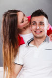 Smiling young couple portrait on gray Stock Photography