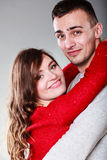 Smiling young couple portrait on gray royalty free stock images