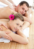 Smiling young couple receiving a back massage Royalty Free Stock Photos