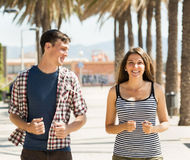 Smiling young couple running outdoor Stock Image