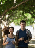 Smiling young couple running outdoor Stock Photography