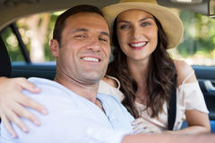Smiling young couple sitting in car Stock Photos