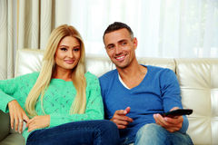 Smiling young couple sitting on the sofa Royalty Free Stock Photo