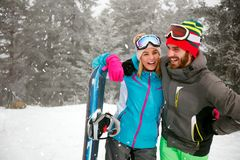 Young couple spend winter holidays at snowy mountain. Smiling young couple spend winter holidays at snowy mountain Stock Image
