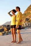 Smiling young couple standing at the beach Royalty Free Stock Photography