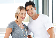 Smiling young couple standing together Royalty Free Stock Photos