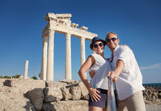 Smiling young couple take a selfie photo on antique ruins Royalty Free Stock Image