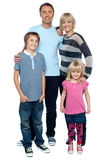 Smiling young couple with their children Stock Photography
