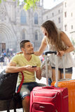 Smiling young couple using phone navigating system Royalty Free Stock Photo