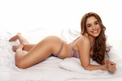 Smiling young curvy woman in lingerie Royalty Free Stock Photos