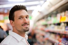 Smiling Young Customer at Supermarket Royalty Free Stock Image