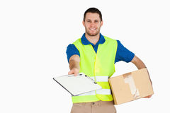 Smiling young delivery man royalty free stock image