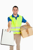 Smiling young delivery man Stock Images