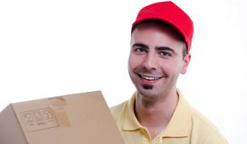Smiling young delivery man. Smiling young courier delivery man with fragile parcel isolated on white background Stock Images