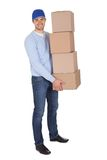 Smiling young delivery man Stock Photography