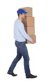 Smiling young delivery man Royalty Free Stock Photography