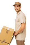 Smiling Young Deliveryman With Cardboard Boxes Stock Photography