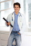 Smiling young doctor Stock Photos