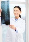 Smiling young doctor in cabinet Royalty Free Stock Images