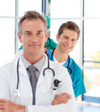 Smiling young doctor in focus in a line Royalty Free Stock Image
