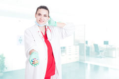 Smiling young doctor holding capsules Royalty Free Stock Photo