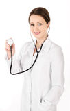 Smiling young doctor woman holding stethoscope isolated Royalty Free Stock Photos