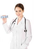 Smiling young doctor woman holding tablets isolated Royalty Free Stock Photos