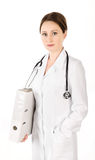 Smiling young doctor woman with stethoscope and folder isolated Stock Images