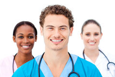 Smiling young doctors standing in a row Stock Photography