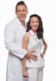 Smiling young doctors in white clothes Stock Photo
