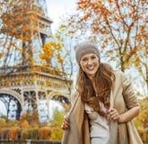 Smiling young elegant woman near Eiffel tower, Paris Royalty Free Stock Image