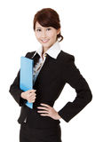 Smiling young executive. Woman of Asian holding file document, half length closeup portrait on white background Stock Photo