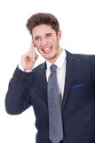 Smiling young executive using cellphone Stock Images