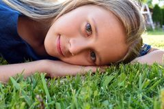 Beautiful young girl close up on  green grass in  summer stock images
